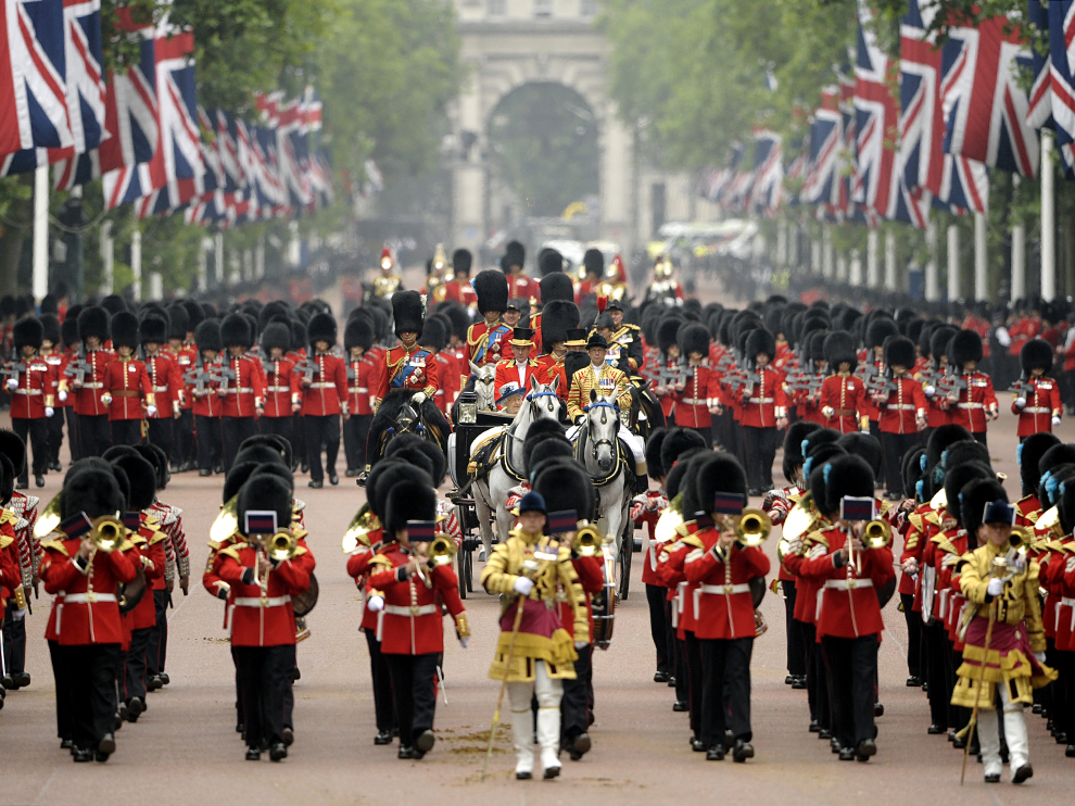 HM Queen Elizabeth II and HRH The Duke of Edinburgh travel down The Mall in an open carriage during the Trooping The Colour, the annual Queen's Birthday Parade, Buckingham Palace, London, UK.  14/06/2014.