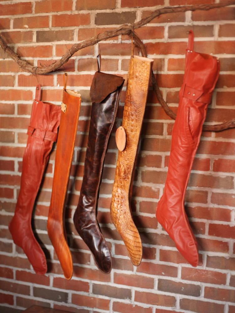 Give your holiday mantel a high-fashion makeover with custom leather Christmas stockings.