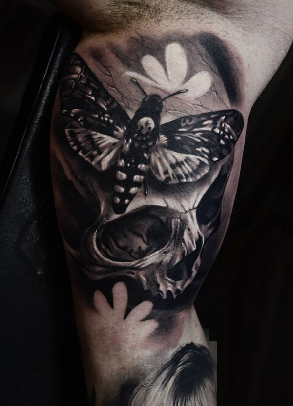 76-Skull-with-moths-tattoo
