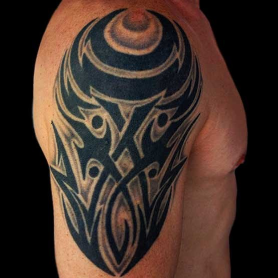 Tribal arm tattoos for guys more masculine look that's become a great attraction for them on women. The man with the tattoos look cool.